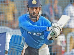 Captain of the Indian cricket team MS Dhoni attempts to play a switch hit at a practice session ahead of the ICC World T20 semifinal match against the West Indies in Mumbai