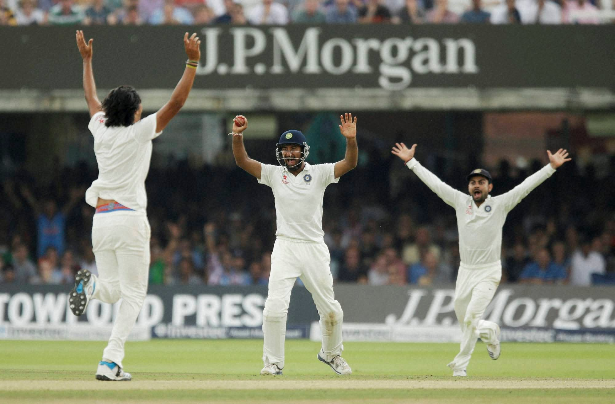 India's, Ishant Sharma, celebrates, Mahendra Singh Dhoni,  wicket, England's Moeen Ali, fifth day, second cricket, test match, England, India, Lord's, cricket, ground, London