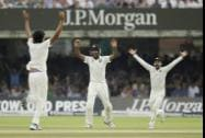 India's Cheteshwar Pujara celebrates catching out England's Moeen Ali off a delivery from Ishant Sharma