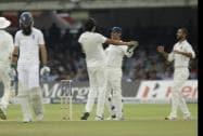 India's Ishant Sharma celebrates with his captain and wicketkeeper Mahendra Singh Dhoni
