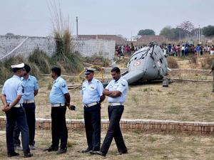 Indian Air Force officers stand near the Chetak helicopter