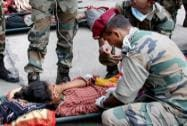 Indian Army personnel attending an injured in quake- hit Kathmandu