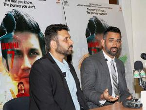 Mahendra Singh Dhoni and producer Arun Pandey at a press conference on his biopic movie