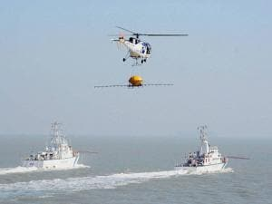 An Indian coast guard chopper demonstrates the procedure in case of an oil fire disaster