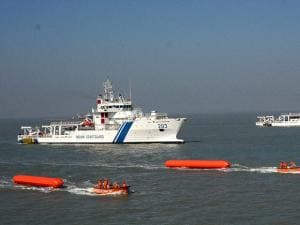 Boasts and personnels of Indian coast guard  demonstrate the procedure incase of an oil fire disaster