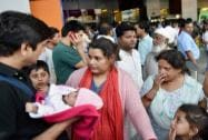 Indians evacuated from earthquake hit Nepal  arrive at IGI airport T3 in New Delhi