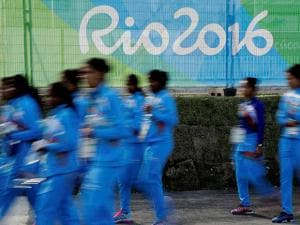 Members of the Indian women's field hockey team walk through the Olympic athletes village in Rio