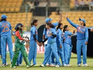 India's cricketers celebrate their win over Bangladesh in the ICC Women's World T20 match at Chinnaswamy Stadium
