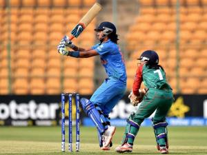 India's Harmanpreet Kaur plays a shot during the ICC Women's World T20 match against Bangladesh at Chinnaswamy Stadium in Bengaluru