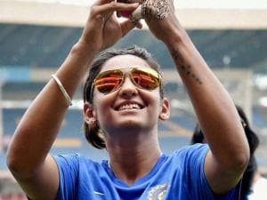 Indian woman cricketer Harmanpreet Kaur clicks a selfie during the practice session ahead of the ICC Women's World T20 match against Bangladesh