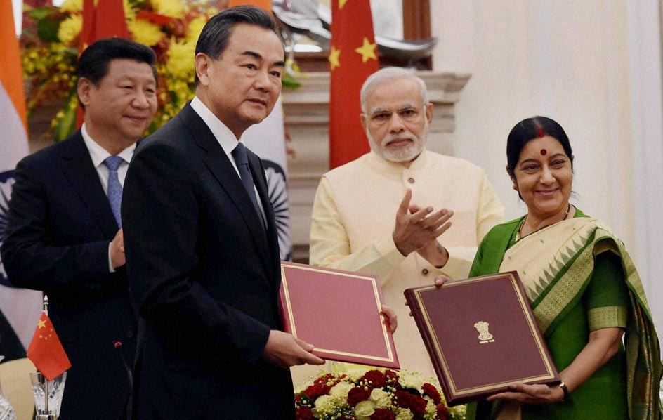 Prime Minister, Narendra Modi, Chinese President, Xi Jinping, clap, External Affairs Minister, Sushma Swaraj, Chinese counterpart, Wang Yi, exchange, files