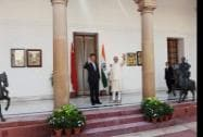 Prime Minister Narendra Modi and Chinese President Xi Jinping wave prior to a meeting at Hyderabad House