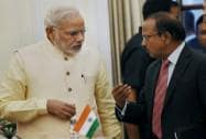 Prime Minister Narendra Modi talks to NSA Ajit Doval during Indo-China agreement signing ceremony