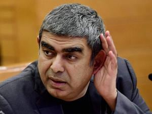 Infosys CEO Vishal Sikka listens to a question during the announcement of the 2nd quarter financial results