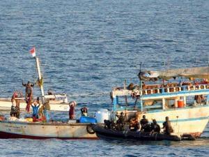 Indian Navy men secure a skiff