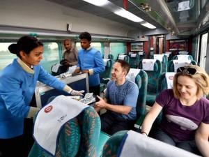 A Train hostess serving passengers aboard the newly launched 'Gatimaan Express', India's first semi-high speed train.