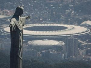 The Christ the Redeemer statue stands in front of the Maracana stadium in Rio de Janeiro