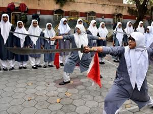 Girl students of St Maaz High School performing a Vietnamese martial art 'Vovinam'