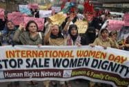 Pakistani women chant slogan during a demonstration a day ahead of International Woman's Day