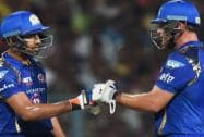 Mumbai Indians batsman Rohit Sharma being greeted by his teammate C. Anderson after completes his half century