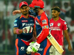 Delhi Daredevils batsman Quinton de Kock and Pawan Negi celebrate their win against Kings XI Punjab during their IPL match  at Feroz Shah Kotla Stadium in New Delhi.