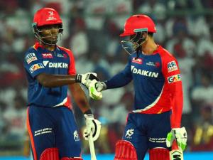 Delhi Daredevils batsman Sanju Samson and  Quinton de Kock greets each other to built up their partnership  during IPL Match  against Kings XI Punjab at Feroz Shah Kotla Stadium in New Delhi