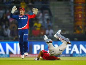 Kings XI Punjab  batsman Axar Patel dives to  complete the run against Delhi Daredevils  during their IPL match  at Feroz Shah Kotla Stadium in New Delhi.