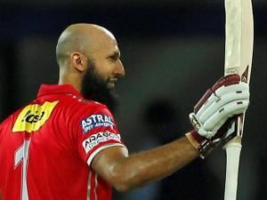 Hashim Amla of Kings XI Punjab celebrates his Hundred runs