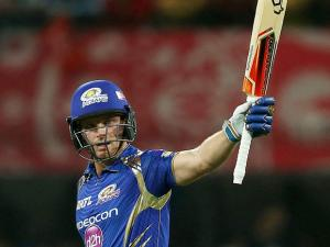 Jos Buttler of the Mumbai Indians raises his bat after reaching fifty runs