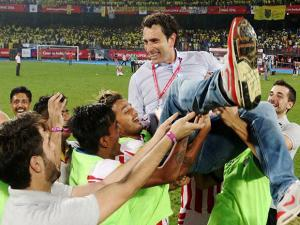 Atletico de Kolkata players celebrate with coach after winning the final