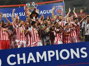Atletico de Kolkata players celebrate with the winning trophy after beating Kerala Blasters
