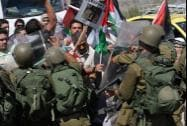 Palestinians confront Israeli soldiers against Israeli military action in Gaza