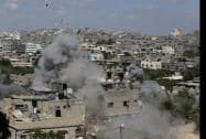 Smoke and debris rises as an Israeli missile strike hits a building in Jabalya refugee camp