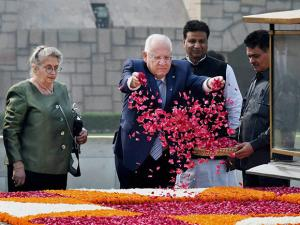 Israeli President Reuven Rivlin and his wife Nechama Rivlin pay floral tribute to Mahatma Gandhi's memorial