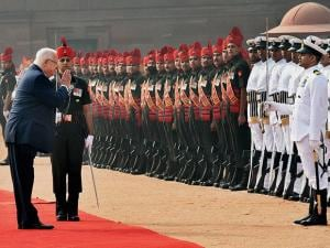 Israeli President Reuven Rivlin inspects the guard of honor during a ceremonial welcome
