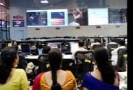 Indian Space Research Organization scientists and other officials watch Prime Minister Narendra Modi