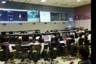 Scientist watching the screen showing the graphic images of the successful insertion of Mars Orbiter