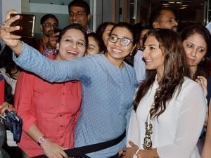 Wrestlers Geeta and Babita Phogat at function marking International Women's Day