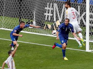 Italy's Giorgio Chiellini, front right, celebrates after scoring the opening goal