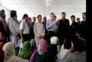 J K CM Omar Abdullah meeting flood affected people  at a relief camp