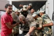 An injured BSF jawan being taken to the Government Medical College Hospital
