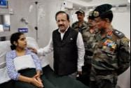 Union Health Minister Harsh Vardhan meets a patient during his visit to Srinagar