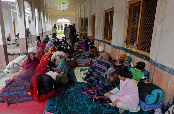 Flood-affected, people, relief camp, gurdwara, Srinagar