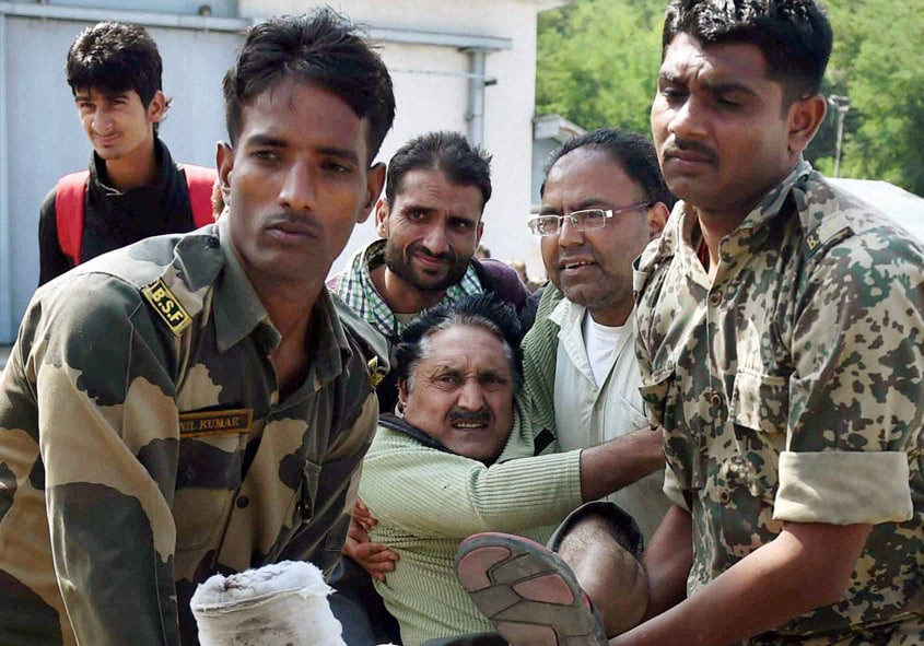 Soldiers, carry, rescued, flood victim, relief camp, Srinagar