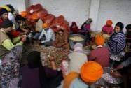 Sikh people preparing food for flood victims at a relief camp at a gurdwara in Srinagar