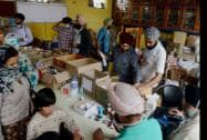 Sikh volunteers dispense medicine for flood victims at a relief camp in a gurdwara in Srinagar