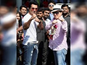Jackie Chan with actor Sonu Sood guestures at the crowd as he arrives at the airport in Mumbai to promote his upcomming film ' Kung FU Yoga'