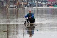 A man moves towards safer place from the flood-hit Pampore area of  Srinagar
