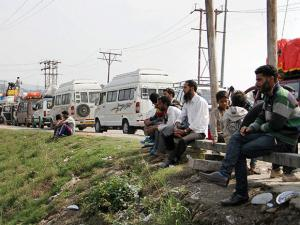 Stranded passengers wait for the opening of the Jammu-Srinagar national highway