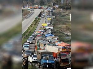 Stranded trucks stand in a line after the Jammu-Srinagar highway was closed on Second day